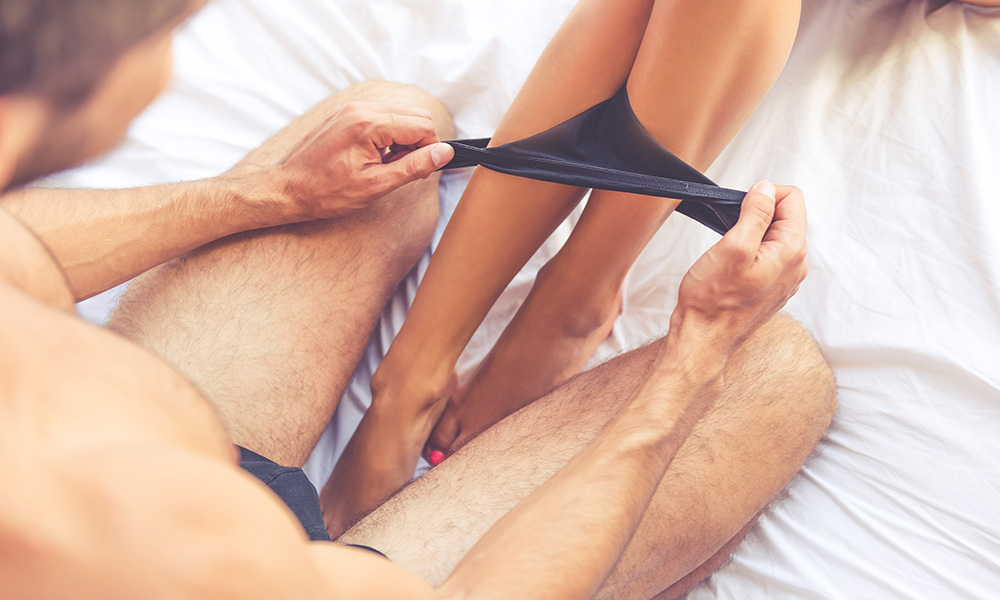 Couple using sex toys